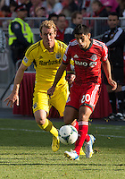 18 May 2013: Toronto FC midfielder Matias Laba #20 and Columbus Crew defender Tyson Wahl #2 in action during an MLS game between the Columbus Crew and Toronto FC at BMO Field in Toronto, Ontario Canada..The Columbus Crew won 1-0...