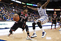 December 8, 2013: Deverell Biggs (1) of the Nebraska Cornhuskers drives the baseline against Jahenns Manigat (12) of the Creighton Bluejays at the CenturyLink Center in Omaha, Nebraska. Creighton defeated Nebraska 82 to 67.
