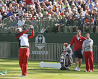 26 SEP 12  Joe LaCava and Sean Foley look on as Tiger Woods hits his driver on the range during Wednesdays practice round at The 39th Ryder Cup at The Medinah Country Club in Medinah, Illinois.