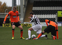 Gavin Gunning (right) and Lee Mair tangle as Stuart Armstrong watches on  in the St Mirren v Dundee United Clydesdale Bank Scottish Premier League match played at St Mirren Park, Paisley on 27.10.12.