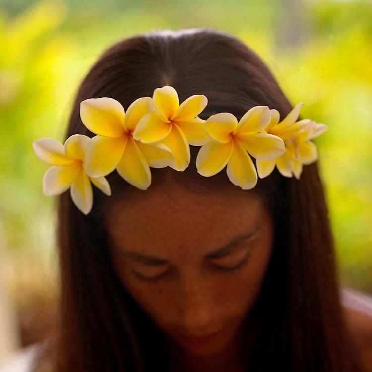 Female Model at the Honua Spa, Hotel Hana Maui, Hawaii wearing a traditional lei made of yellow plumeria