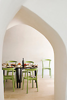 View through a contemporary archway to a table laid for dinner