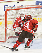 Carmen MacDonald (SLU - 30), Vanessa Emond (SLU - 14) - The Boston College Eagles defeated the visiting St. Lawrence University Saints 6-3 (EN) in their NCAA Quarterfinal match on Saturday, March 10, 2012, at Kelley Rink in Conte Forum in Chestnut Hill, Massachusetts.