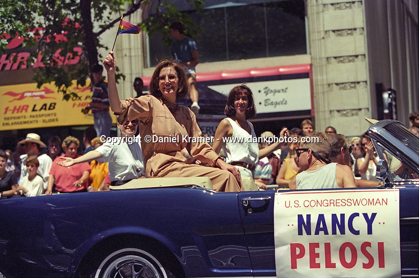 Congresswoman Nancy Pelosi waves the rainbow flag during the Gay Rights Parade in San Francisco in 1995.
