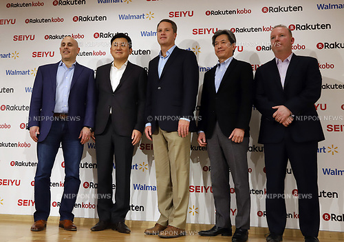 "January 26, 2018, Tokyo, Japan - (L-R) US retail giant Walmart e-commerce chief executive officer Marc Lore, Japanese online commerce giant Rakuten president Hiroshi Mikitani, Walmart president Doug McMillon, Walmart's Japanese subsidiary Seiyu president Takeshi Kamigouchi and Rakuten's wbook subsidiary rakuten Kobo chief marketing officer Alan MacNevin as they announce a new strategic alliance on the e-commerce at the Rakuten headquarters in Tokyo on Friday, January 26, 2018. Rakuten and Walmart will launch a new online grocery delivery service ""Rakuten Seiyu Netsuper"" in Japan in this year. (Photo by Yoshio Tsunoda/AFLO) LWX -ytd-"