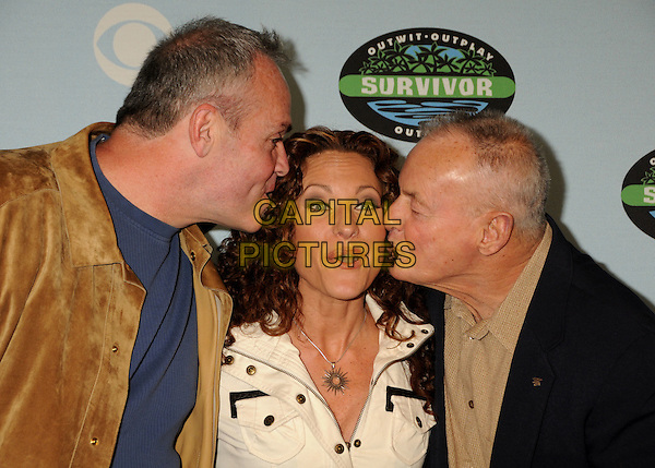 "RICHARD HATCH, JERRI MANTHEY & RUDY BOESCH.""Survivor"" 10 Year Anniversary Party held at CBS Studios, Los Angeles, California, USA, 9th January 2010..portrait headshot brown suede kissing cheeks funny .CAP/ADM/BP.©Byron Purvis/AdMedia/Capital Pictures."