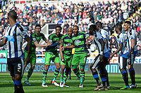 Swansea City players (l-r in blue and green stripes) Federico Fernandez, Leroy Fer, Andre Ayew and Ashley Williams line up for a corner kick during the Barclays Premier League match between Newcastle United and Swansea City played at St. James' Park, Newcastle upon Tyne, on the 16th April 2016