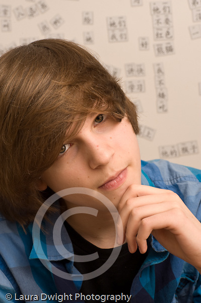 portrait of 14 year old teenage boy closeup Caucasian vertical