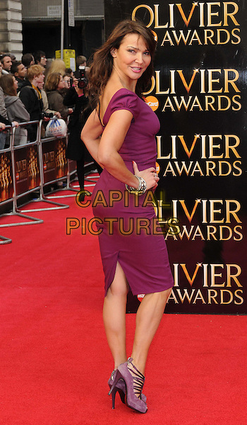 Lizzie Cundy.The Olivier Awards 2012, Royal Opera House, Covent Garden, London, England..April 15th, 2012.full length dress purple hands on hips side .CAP/CAN.©Can Nguyen/Capital Pictures.
