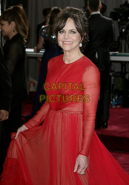 Sally Field (wearing Valentino).85th Annual Academy Awards held at the Dolby Theatre at Hollywood & Highland Center, Hollywood, California, USA..February 24th, 2013.oscars half length red sheer dress long sleeves .CAP/ADM.©AdMedia/Capital Pictures.