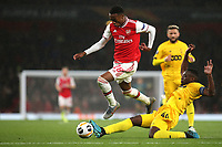 Ainsley Maitland-Niles of Arsenal skips over a challenge from Paul-Jose Mpoku of Standard Liege during Arsenal vs Standard Liege, UEFA Europa League Football at the Emirates Stadium on 3rd October 2019