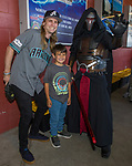 "David and six-year-old Czeith pose with a Star Wars character during the Reno Aces ""Star Wars Night"" in Reno on Saturday, June 8, 2019."