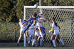 29 November 2013: Duke's Natasha Anasi (in blue) and Virginia Tech's Murielle Tiernan (above, right) challenge for a header. The Virginia Tech University Hokies played the Duke University Blue Devils at Thompson Field in Blacksburg, Virginia in a 2013 NCAA Division I Women's Soccer Tournament Quarterfinal match. Virginia Tech won the game 3-0.