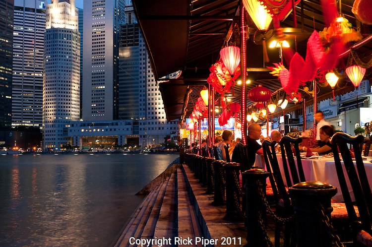 Riverside restaurants in the evening on the Boat Quay, Singapore