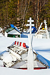 "Colored ""spirit houses"" on the burial grounds, combined customs of Athabaskan and Russian Orthodox practices, Eklutna Cemetary, Eklutna Village Historical Park, Southcentral Alaska, Winter."