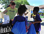 Activity at the FAMILY Child Care of Ulster County booth, one of the many booths set up at the Midtown Make a Difference Day 2016, on Franklin Street, in Kingston, NY on Saturday, June  18, 2016. Photo by Jim Peppler. Copyright Jim Peppler 2016.