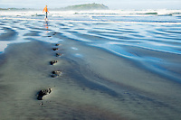 Footprints in the sand, New Zealand