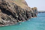Kayaking past cliffs near Kynance Cove, Lizard peninsula, Cornwall, England, UK