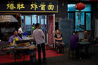 A traditional local restaurant is seen in Qianmen Street area of Beijing on May 30, 2012. Qianmen Street area has a history of more than 570 years. The shopping area was called Zhengyangmen Street during the Ming and Qing Dynasties, and finally named Qianmen Street in 1965. (Leica M9, 50mm f1.4)