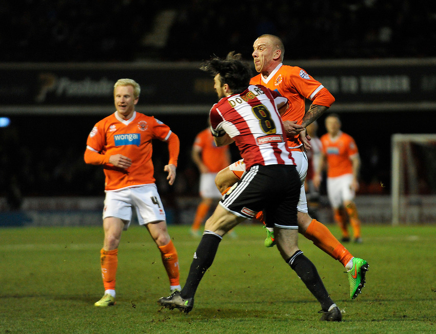 Blackpool's Jamie O'Hara injures himself after clashing with Jonathan Douglas<br /> <br /> Photographer Ashley Western/CameraSport<br /> <br /> Football - The Football League Sky Bet League One - Brentford v Blackpool - Tuesday 24th February 2015 - Griffin Park - London<br /> <br /> &copy; CameraSport - 43 Linden Ave. Countesthorpe. Leicester. England. LE8 5PG - Tel: +44 (0) 116 277 4147 - admin@camerasport.com - www.camerasport.com