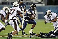 6 November 2010:  FIU running back Darriet Perry (28) carries the ball in the second quarter as the FIU Golden Panthers defeated the University of Louisiana-Monroe Warhawks, 42-35 in double overtime, at FIU Stadium in Miami, Florida.