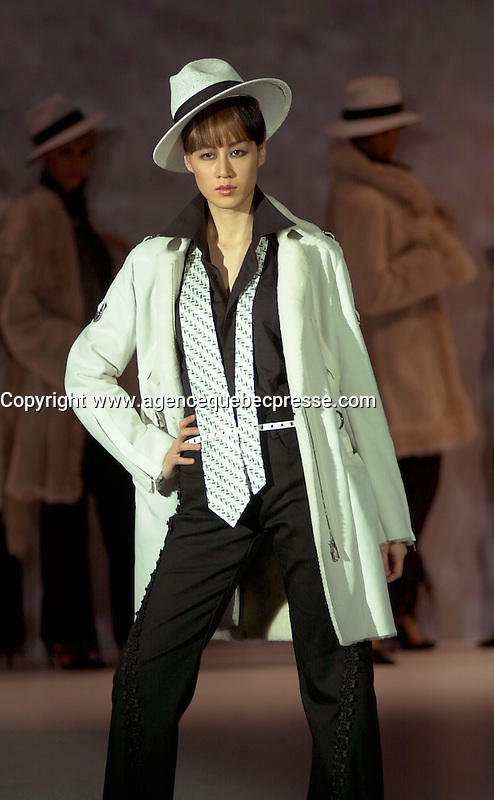 May 4,  2003, Montreal, Quebec, Canada<br /> <br /> The NAFFEM (North American Fur and Fashion-Montreal) annual fashion show display the latest trends by Canadian and International fur designers, May 4 2003, in Montreal, Canada<br /> <br /> Mandatory Credit: Photo by Pierre Roussel- Images Distribution. (&copy;) Copyright 2003 by Pierre Roussel <br /> <br /> NOTE : <br />  Nikon D-1 jpeg opened with Qimage icc profile, saved in Adobe 1998 RGB<br /> .Uncompressed  Original  size  file availble on request.