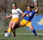 BROOKINGS, SD - OCTOBER 18: Roxy Roemer #4 from North Dakota State looks for a teammate as Alyssa Brazil #15 from South Dakota State tries to steal the ball during their game Sunday afternoon at Fischback Soccer Field in Brookings. (Photo by Dave Eggen/Inertia)