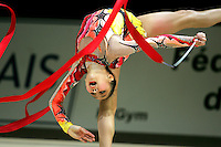 Aliya Garaeva competing for Azerbaijan releases back flexion with ribbon waves during All-Around competition at 2006 Thiais Grand Prix in Paris, France on March 25, 2006.  (Photo by Tom Theobald)