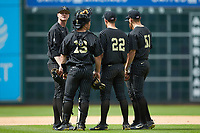 (L-R) Drake Fellows (66), Stephen Scott (19), Julian Infante (22), and JJ Bleday (51) meet near the mound during the game against the Sam Houston State Bearkats in game one of the 2018 Shriners Hospitals for Children College Classic at Minute Maid Park on March 2, 2018 in Houston, Texas. The Bearkats walked-off the Commodores 7-6 in 10 innings.   (Brian Westerholt/Four Seam Images)