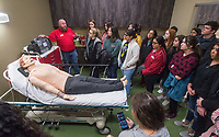NWA Democrat-Gazette/BEN GOFF @NWABENGOFF<br /> Grant Wilson (left), emergency medical services clinical coordinator, talks to a group of Rogers High students about a defibrillator and training mannequin Friday, Jan. 11, 2019, at Northwest Arkansas Community College in Bentonville. About 120 9th-12th grade students from medical professions classes at Rogers High School visited the community college for tours of the health professions building. The field trip was organized by teacher Marty Allen to help the students learn about education and career opportunities in healthcare.