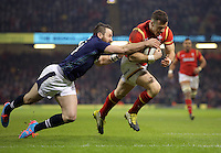 Gareth Davies of Wales (R) chased by Tommy Seymour of Scotland (L) on his final run, before scoring the first try for his team during the RBS 6 Nations Championship rugby game between Wales and Scotland at the Principality Stadium, Cardiff, Wales, UK Saturday 13 February 2016