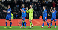 Bolton Wanderers' David Wheater, Mark Beevers, Ben Alnwick, Pawel Olkowski and Gary O'Neil applauds their side's travelling supporters at the end of the match<br /> <br /> Photographer Andrew Kearns/CameraSport<br /> <br /> The EFL Sky Bet Championship - Hull City v Bolton Wanderers - Tuesday 1st January 2019 - KC Stadium - Hull<br /> <br /> World Copyright © 2019 CameraSport. All rights reserved. 43 Linden Ave. Countesthorpe. Leicester. England. LE8 5PG - Tel: +44 (0) 116 277 4147 - admin@camerasport.com - www.camerasport.com