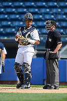 Staten Island Yankees catcher Isaias Tejeda #29 talks with umpire Rich Grassa during a game against the Connecticut Tigers on July 7, 2013 at Richmond County Bank Ballpark in Staten Island, New York.  Staten Island defeated Connecticut 6-2.  (Mike Janes/Four Seam Images)