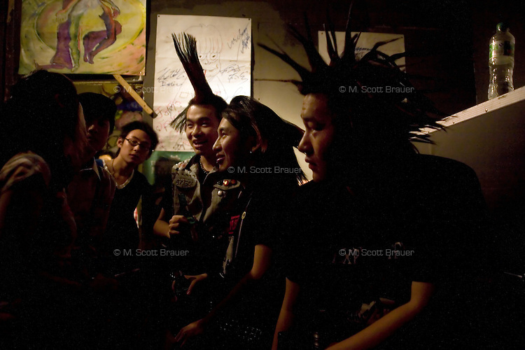 Punk fans and musicians gather backstage at Live Bar in Shanghai, China.