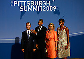 Pittsburgh, PA - September 24, 2009 -- United States President Barack Obama (2L) and U.S. first lady Michelle Obama (R) welcome Russian President Dmitry Medvedev (L) and his wife Svetlana Medvedeva before the welcoming dinner for G-20 leaders at the Phipps Conservatory on Thursday, September 24, 2009 in Pittsburgh, Pennsylvania. Heads of state from the world's leading economic powers arrived today for the two-day G-20 summit held at the David L. Lawrence Convention Center aimed at promoting economic growth. .Credit: Win McNamee / Pool via CNP