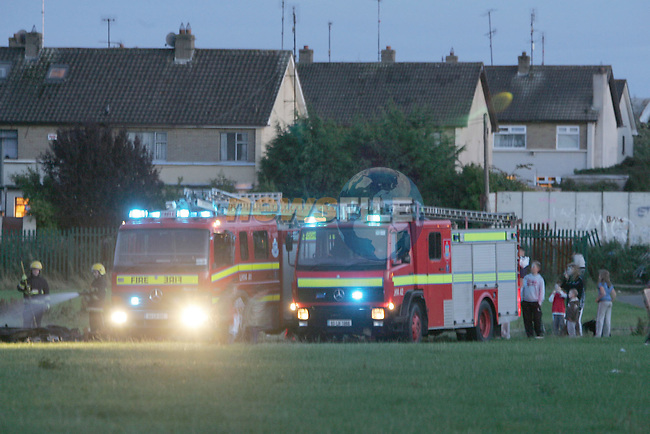 Two units of the Drogheda Fire Service attended a large rubbish fire on the green in Moneymore. Rubbish, tyres and Timber pallets were set on fire on Monday Evening..Photo: Fran Caffrey/ Newsfile.