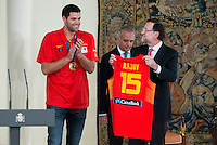 The reception of Prime Minister Mariano Rajoy to Spain national basketball team gold at EuroBasket 2015 at Moncloa Palace in Madrid, 21 September, 2015.<br /> Felipe Reyes delivers shirt with the number of Mariano Rajoy.<br /> (ALTERPHOTOS/BorjaB.Hojas) /NortePhoto.com