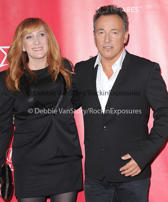 Bruce Springsteen and Patti Scialfa at The MusiCares® 2013 Person Of The Year Tribute held at The Los Angeles Convention Center, West Hall in Los Angeles, California on February 08,2013                                                                   Copyright 2013 Hollywood Press Agency