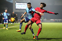 Paris Cowan-Hall of Wycombe Wanderers and Sandro Semedo of Leyton Orient (22) during the Sky Bet League 2 match between Wycombe Wanderers and Leyton Orient at Adams Park, High Wycombe, England on 17 December 2016. Photo by David Horn / PRiME Media Images.