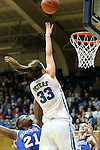 17 November 2012: Duke's Haley Peters (33) shoots over Presbyterian's Keyonna Allen (21). The Duke University Blue Devils played the Presbyterian College Blue Hose at Cameron Indoor Stadium in Durham, North Carolina in an NCAA Division I Women's Basketball game. Duke won the game 84-45.
