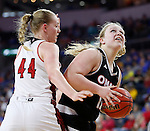 SIOUX FALLS, SD: MARCH 5:  Courtney Voucher #10 of Omaha drives on Abigail Fogg #44 of South Dakota during the Summit League Basketball Championship on March 5, 2017 at the Denny Sanford Premier Center in Sioux Falls, SD. (Photo by Dick Carlson/Inertia)