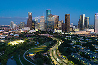 Houston Skyline at Blue Hour -  Right after the sun goes down and the lights come on the buildings in downtown Houston light up and you have the blue hour. The blue hour or twilight is when the sky is still blue and the lights shine through to show this vibrant city in downtown with this great skyline in the background.  The Eleanor Tinley Park run along the Allen Parkway and Memorial Drive with the Buffalo Bayou snaking it way through the park.  After dark you can see the lights at the Jamail skate park along the townhouses next to the Allen Parkway with a little light still from the sun set earlier still reflecting off some of the buildings.  Houston has some of the tallest skyscrapers in the south, it is a city that was made from the energy industry.  Some used to say Houston has it cows and it oil,  but things have changed a lot since I grew up here for this vibrant diverse city with many business including banking, tech and several universities like Rice, University of Houston not to mention a top place for art, music, museums, and some top knotch sports team like the Astros and along with many others.
