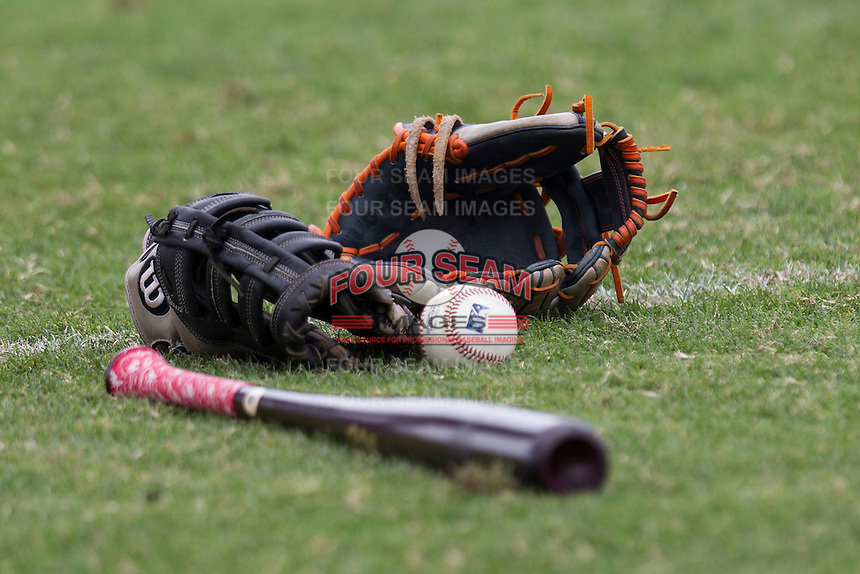 Bat, baseball and gloves on May 10, 2015 at Nelson Wolff Stadium in San Antonio, Texas. The Missions defeated the Hooks 6-5. (Andrew Woolley/Four Seam Images)