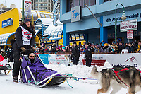Magnus Kaltenborn and team leave the ceremonial start line with an Iditarider and handler at 4th Avenue and D street in downtown Anchorage, Alaska on Saturday March 3rd during the 2018 Iditarod race. Photo ©2018 by Brendan Smith/SchultzPhoto.com