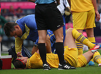 Women's Olympic Football match France v Sweden on 3.8.12...Lotta Schelin of Sweden getting treatment, during the Women's Olympic Football match between France v Sweden at Hampden Park, Glasgow...............