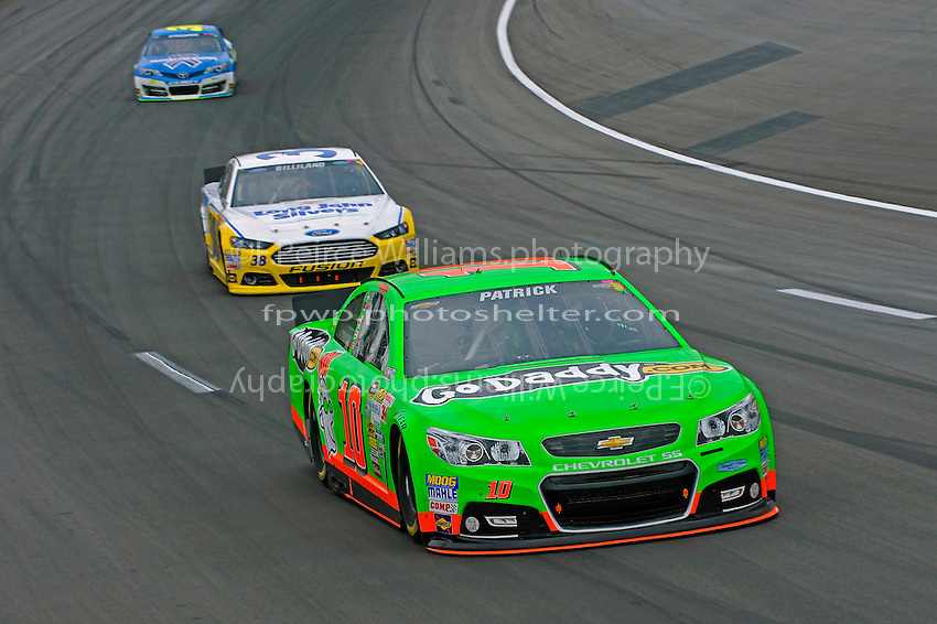 Danica Patrick (#10) leads David Gilliland (#38) and Ryan Newman (#39)