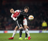 Mesut Ozil of Arsenal & Michel of Qarabag during the UEFA Europa League match between Arsenal and Qarabag FK at the Emirates Stadium, London, England on 13 December 2018. Photo by Andy Rowland.