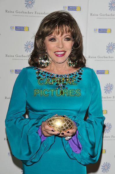 JOAN COLLINS.At the Russia Midsummer Fantasy, in aid of the Raisa Gobachev Foundation, Stud House, Home Park, Hampton Court, England, UK, 7th June 2008. .arrivals half length blue green stones turquoisejewel encrusted earrings dress long sleeves sleeved gold purse clutch bag.CAP/PL.©Phil Loftus/Capital Pictures