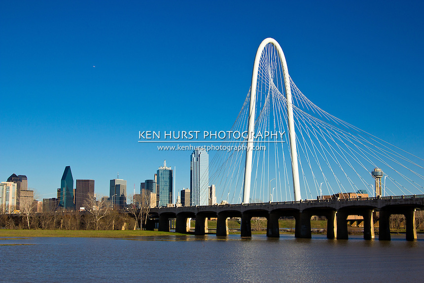 The newly constructed Margaret Hunt Hill bridge, designed by Santiago Calatrava, running parallel to the older Continental Ave. bridge leading into Dallas, Texas.