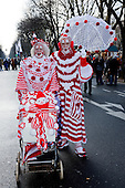 2 March 2014, Duesseldorf, Germany. Pictured: a couple with a fully-knitted and crochet clowns' costumes. Costumed carnival-goers enjoy the sunshine as they celebrate with a street party in Duesseldorf, North Rhine-Westphalia, Germany.